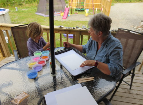 Sand painting with Nana. KinderArt.com