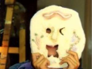 Girl holding mask