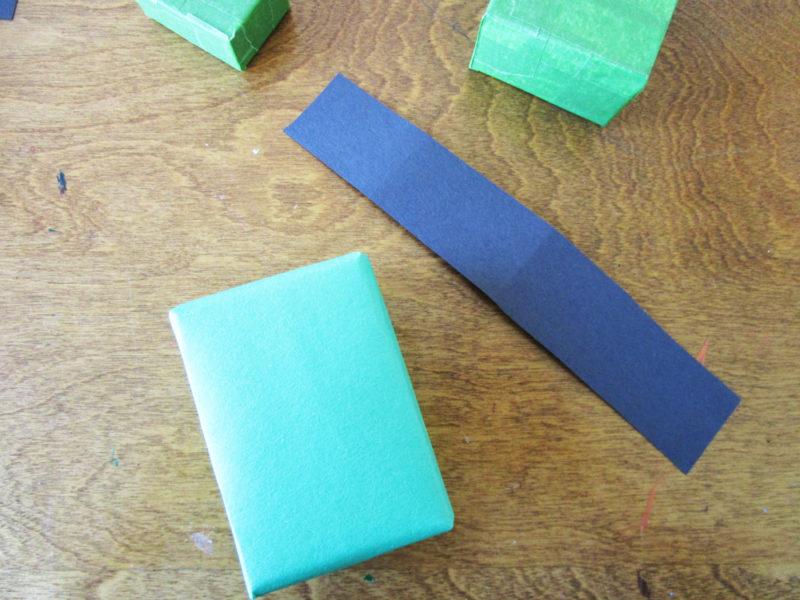 Add construction paper embellishments.