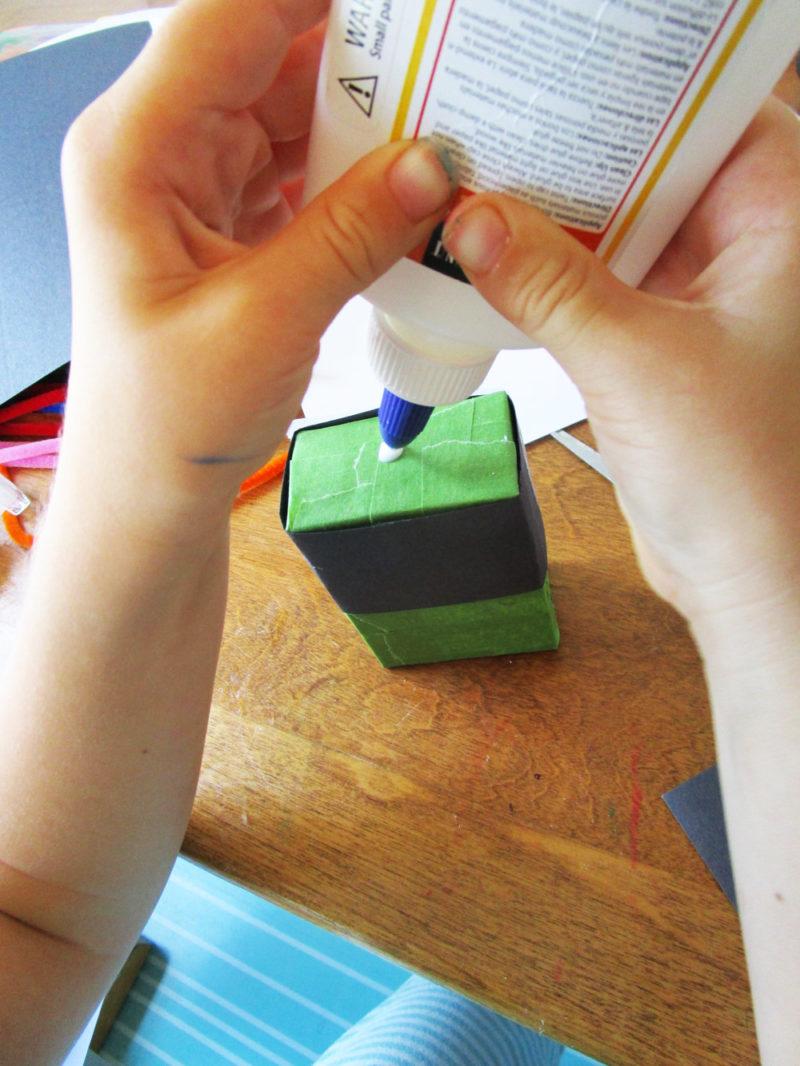 Glue paper onto the box.