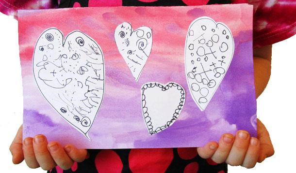 Mixed media Valentine in child's hands.
