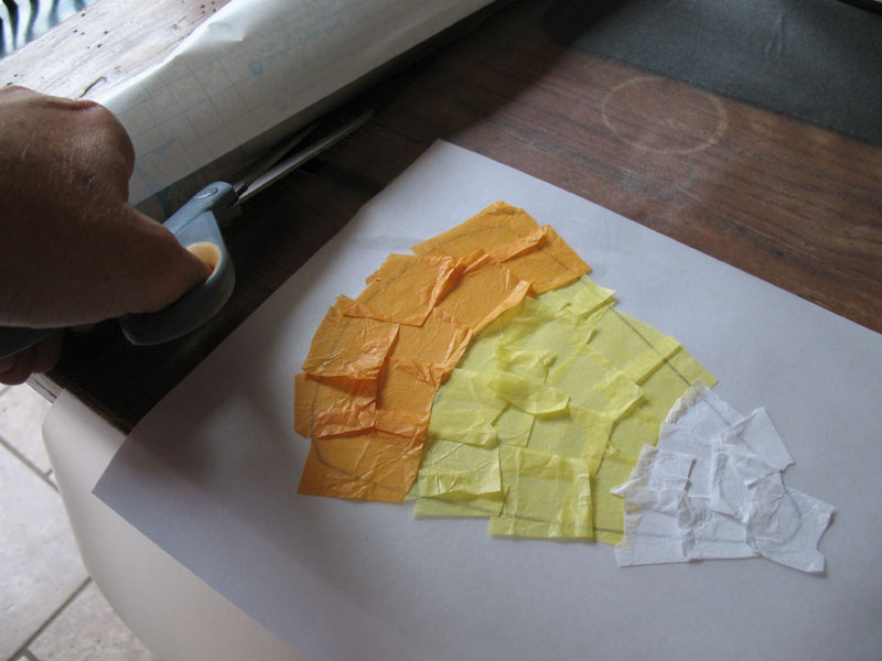 Finish off the top of the candy corn with white tissue paper squares.