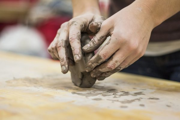 Working with clay.