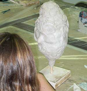 Adding detail to the clay head
