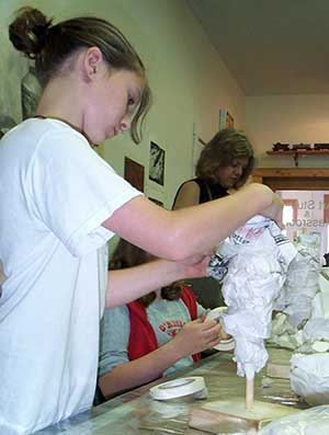 Make a base of paper for your clay head.