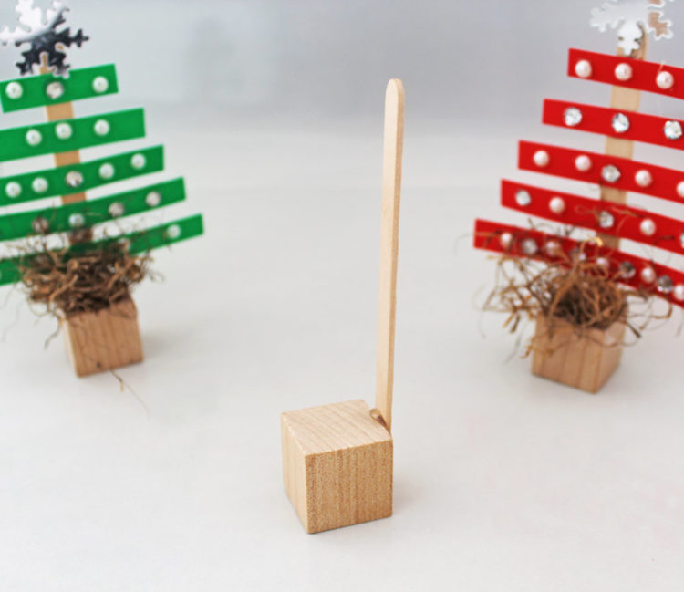 Make the base of your tree with a small wooden block.