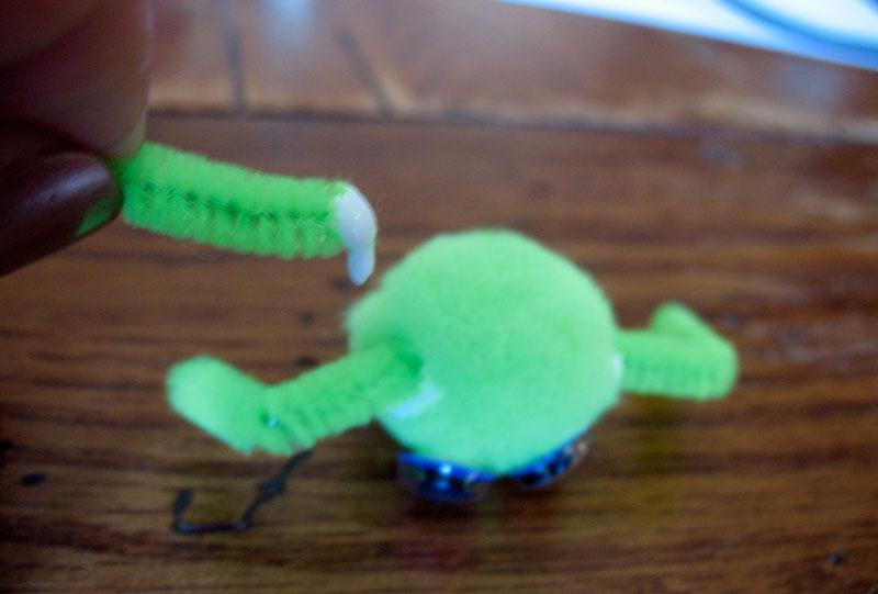 Glue the legs onto the pom-pom. Set the spider aside to dry.