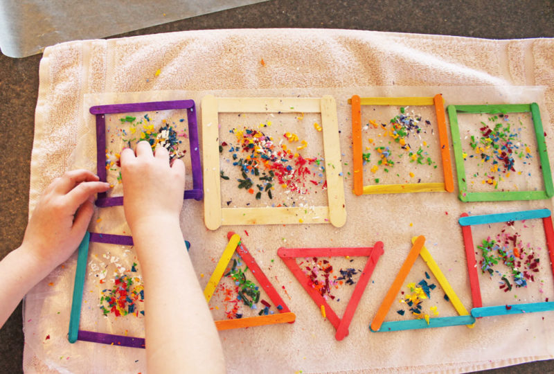 Place crayon shavings into the frames.