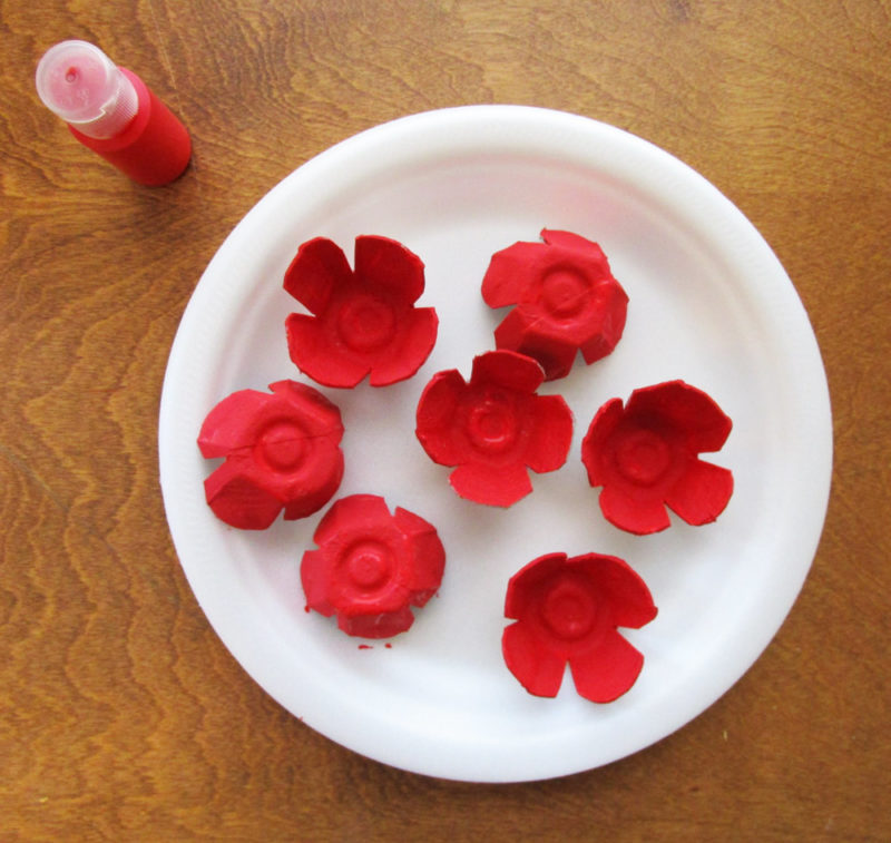 Paint the poppy shapes.