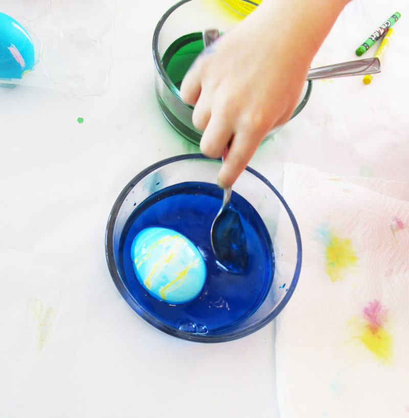 Dip the egg into the dye.