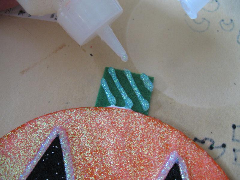 Use white glitter glue to add diagonal stripes to the stem.