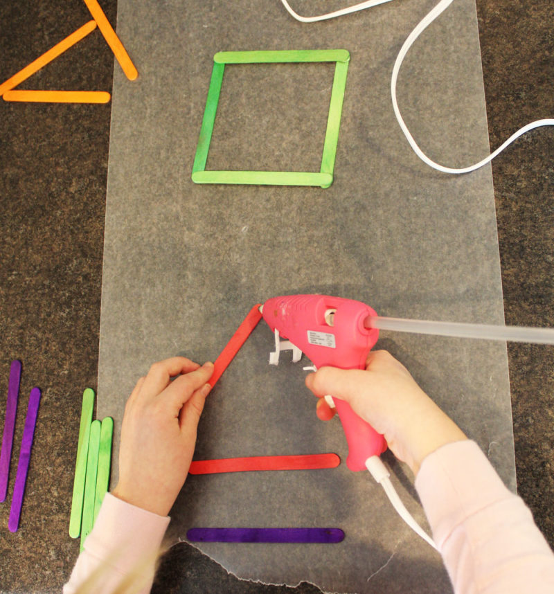 Glue the craft sticks together into frames.