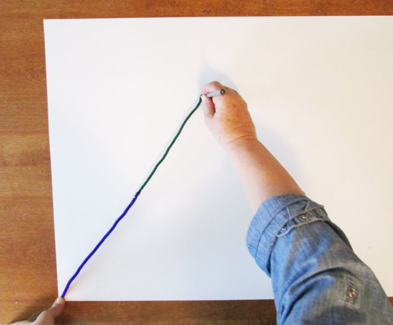 Draw a line on the paper to measure.