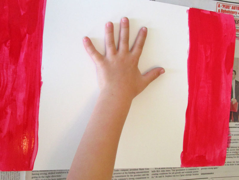 The first handprint goes on the paper.