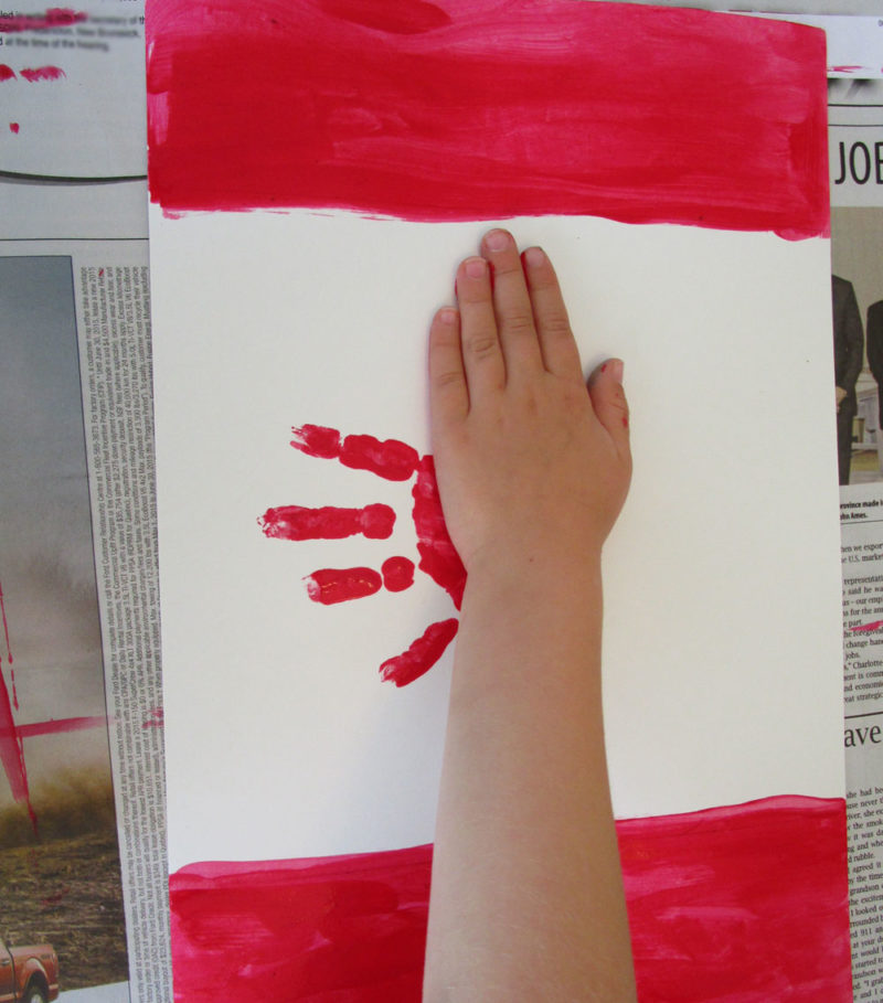 Turn the paper, add more handprints.