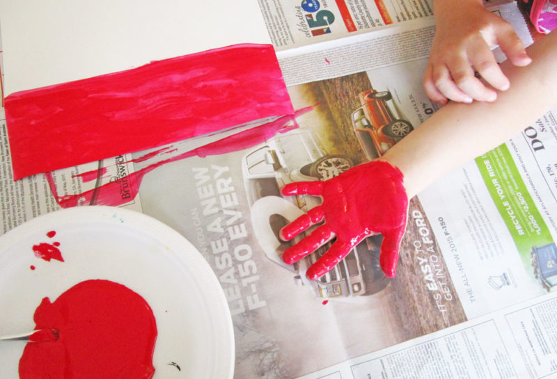 Cover the palm with red paint.