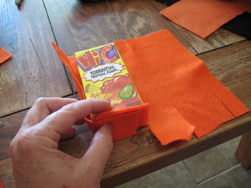 Cover the juice box with orange felt.