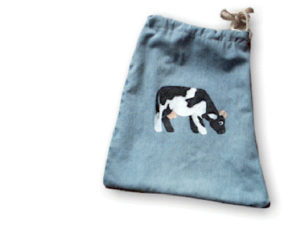 Make a folk art book bag out of a pair of old denim jeans. KinderArt.com