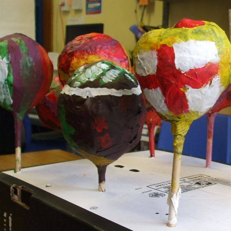 Make maracas with balloons and paper mache.