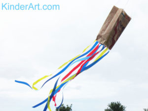 Make a paper bag kite.