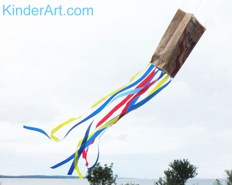 Make a paper bag kite.