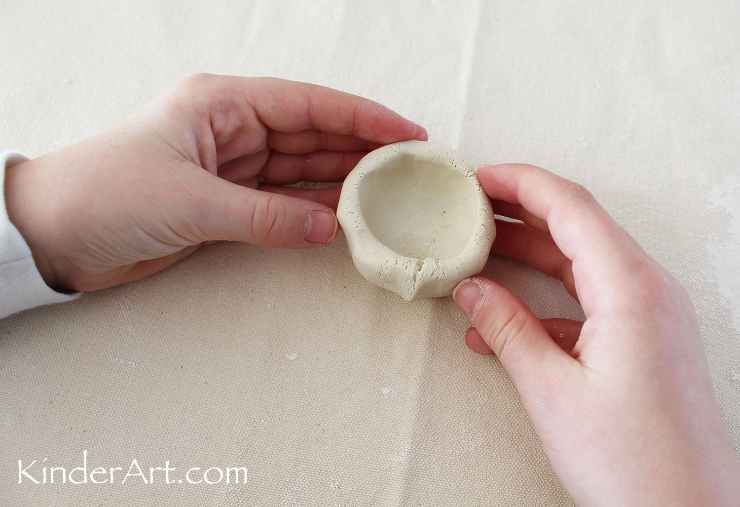 Clay pinch pot.