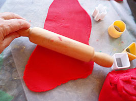 Rolling the play dough.