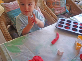 Making balls with the play dough.