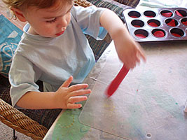Making sausages with the play dough.