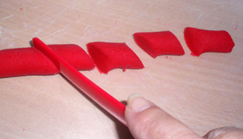 Cutting the play dough.