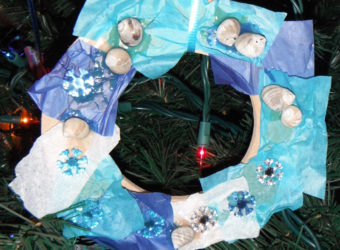 Ocean-inspired wreath decoration craft for kids. KinderArt.com