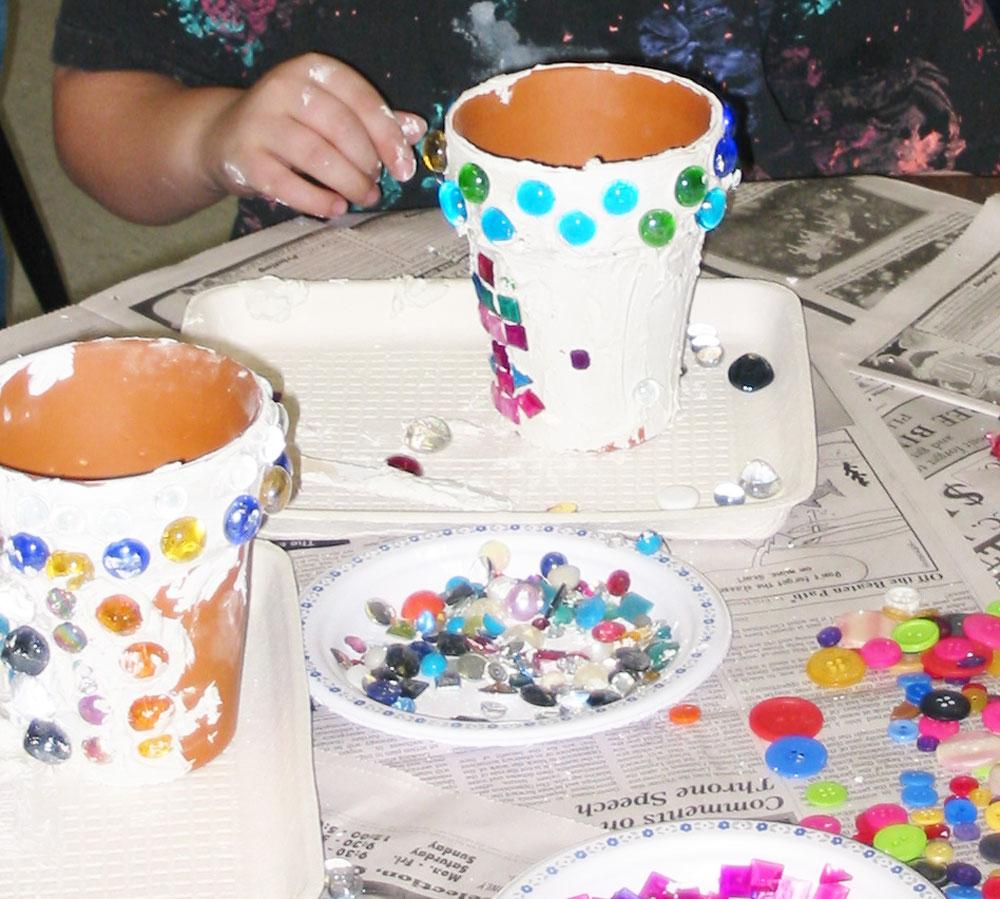 Make mosaic flowerpots without using grout. KinderArt.com art lesson plans.