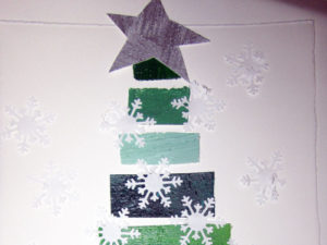Paper Snowflake Tree craft from KinderArt.com