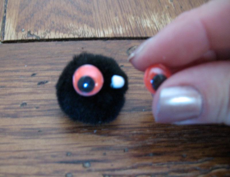 Glue the wiggle eyes onto the black pom-pom and set aside to dry.