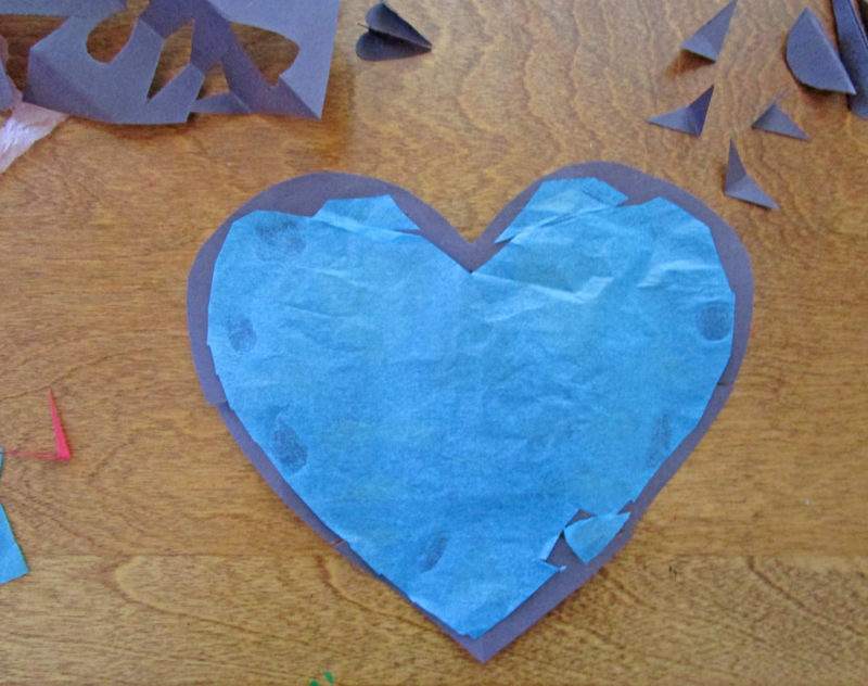 Glue tissue paper to the back of the heart cut out. Faux Stained Glass Hearts Lesson Plan. KinderArt.com