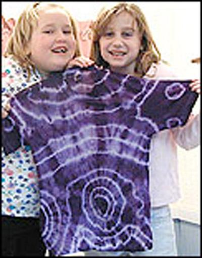 Girls with tie dye shirt.
