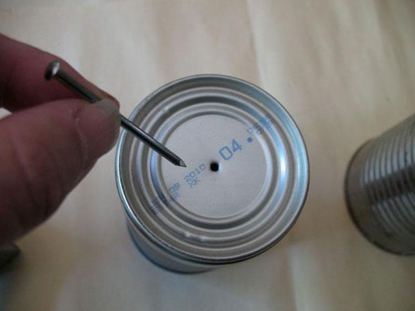 Make a tin can telephone.