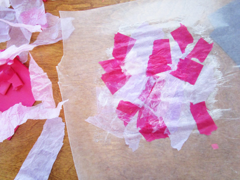 Glued tissue paper. Faux Stained Glass Hearts Lesson Plan. KinderArt.com