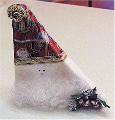 Whimsical Wooden Santa Craft. KinderArt.com